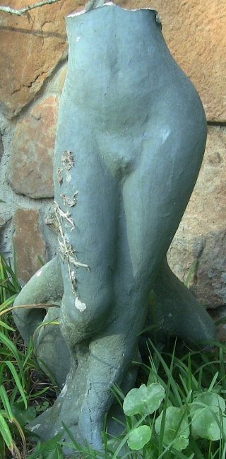 photo of a broken statue of a Greek nymph.